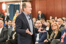 Photo of John Chambers in front of a crowd
